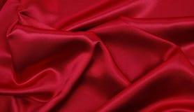 Släta elegant röd lyxig torkduketextur för silke eller för satäng som abstrac Royaltyfri Bild