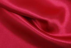 Släta elegant röd lyxig torkduketextur för silke eller för satäng som abstrac Royaltyfria Bilder
