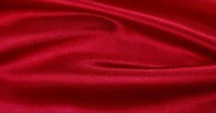 Släta elegant röd lyxig torkduketextur för silke eller för satäng som abstrac Arkivfoton