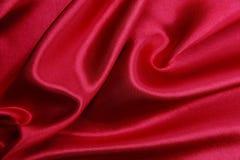 Släta elegant röd lyxig torkduketextur för silke eller för satäng som abstrac Royaltyfria Foton