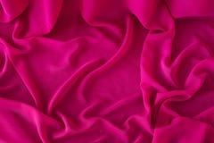 Släta elegant rosa chiffong- eller satängtextur som bakgrund royaltyfria foton
