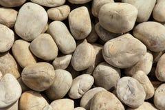 släta stenar för bakgrund Fotografering för Bildbyråer