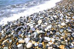 Släta stenar för runda Arkivfoto
