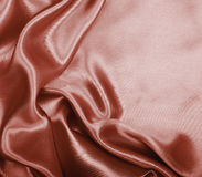Slätt elegant brunt chokladsilke som bakgrund Royaltyfri Fotografi