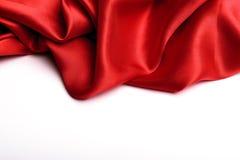 Slätt elegant rött silke royaltyfri bild
