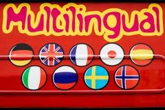 Slående rött flerspråkigt tecken Fotografering för Bildbyråer