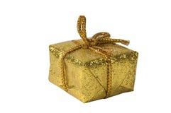 slågen in paper present för guld Arkivbilder