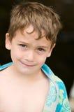 slågen in pojkehandduk Fotografering för Bildbyråer