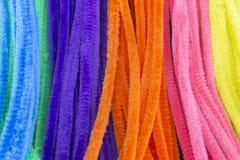 Slösa, göra grön, lilor, apelsinen, rosa färg och gulna bakgrund för rörrengöringsmedel Arkivbild