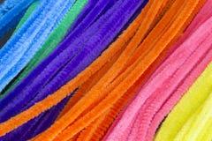 Slösa, göra grön, lilor, apelsinen, rosa färg och gulna bakgrund för rörrengöringsmedel Royaltyfri Bild