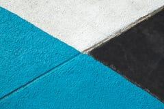 Slösa, grå färger och vit texturerad yttersida av asfalt för abstrakt bakgrund Royaltyfri Bild