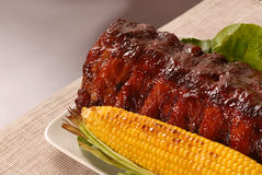 Slab of barbeque ribs and corn Royalty Free Stock Photos