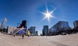 The slab of the La Défense business district near Paris. The slab of the business district of La Défense near Paris at lunchtime by a big sun with stock images
