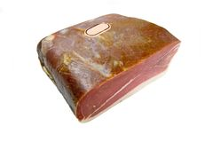Slab of meat. A slab of meat wrapped up in polythene wrap on isolated background Royalty Free Stock Images