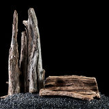 Slab resting on a pile of black rocks Stock Photo