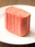 Slab of spam on a plate. Close up of a slab of spam on a plate Stock Images