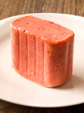 Slab of spam on a plate. Close up of a slab of spam on a plate Stock Photo