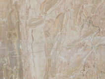 Slab of striped beige marble Stock Photography