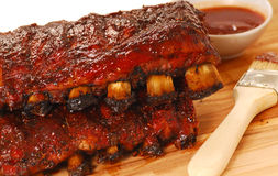 Slabs of BBQ Spare ribs. Two slabs of delicious BBQ spare ribs with dipping sauce royalty free stock photo