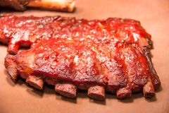 Slabs of BBQ spare ribs with dipping sauce stock photography