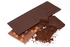 Slabs chocolate nd grated chocolate isolated Stock Images
