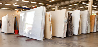 Slabs of granite in a storage warehouse Stock Images