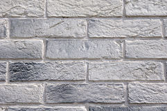 Slabs imitation bricks on wall closeup Royalty Free Stock Photography