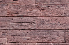 Slabs imitation red wood on wall closeup Royalty Free Stock Photo