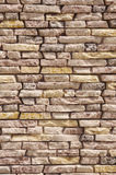 Slabs imitation stone on wall closeup Royalty Free Stock Photography