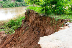 Slabs with landslide. Damage to the broken slabs under the road alongside the river, which eroded landslide erosion Stock Photos