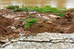 Slabs with landslide. Damage to the broken slabs under the road alongside the river, which eroded landslide erosion Stock Photo