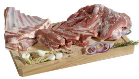Slabs of meat on cutting board Royalty Free Stock Photo
