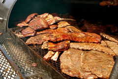 Slabs Of Ribs Cook Inside Industrial Grill At Festival Royalty Free Stock Photos