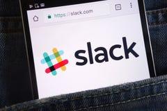 Slack website displayed on smartphone hidden in jeans pocket. KONSKIE, POLAND - JUNE 02, 2018: Slack website displayed on smartphone hidden in jeans pocket royalty free stock photography
