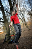 Slackline. Man balancing on the slackline in the outdoor Royalty Free Stock Photo