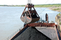 Slackline cableway bucket with coal at river port Stock Photo