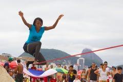 Slackline on Copacabana beach, Rio de Janeiro royalty free stock image