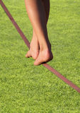 Slackline feet over grass Stock Images
