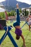 Slackline yoga at the Wanderlust festival in Whistler, Canada Stock Photo