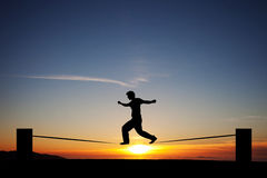 Slackliner in sunset Stock Photos
