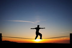 Slackliner in sunset Royalty Free Stock Images