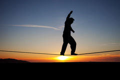 Slackliner in sunset royalty free stock photos