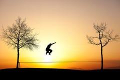 Slackliner in sunset stock photography
