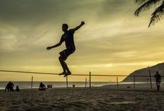 Slacklining at Ipanema Beach in Rio de Janeiro Royalty Free Stock Photos