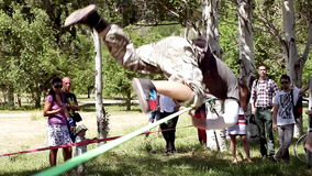 Slacklining master show their skills to the public stock footage