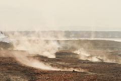 Smoke on slag dump, pollution. Slag dump, smoke on slag dump, pollution Royalty Free Stock Photography