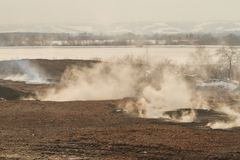 Smoke on slag dump, pollution. Slag dump, smoke on slag dump, pollution Stock Photography