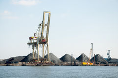 Slag heaps of coal on the wharf Stock Photos