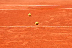 Slag tennis court and balls Royalty Free Stock Photo