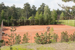 Slag tennis courts. In the wood Stock Photography